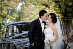 Melissa & Adrian with wedding bouquet